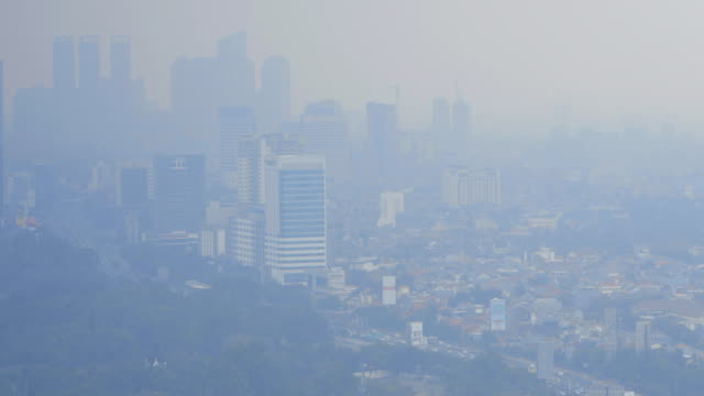 jakarta skyline and extreme pollution - smog stock videos & royalty-free footage