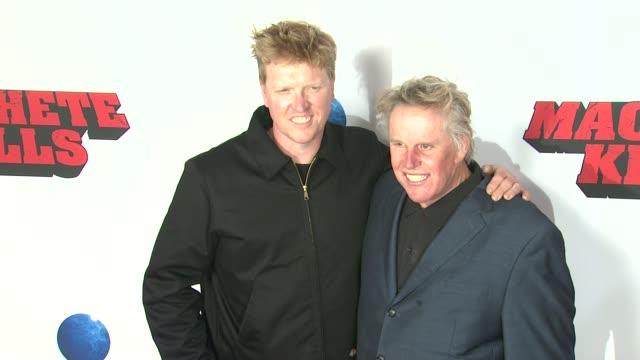Jake Busey and Gary Busey at Machete Kills Los Angeles Premiere Jake Busey and Gary Busey at Machete Kills Los at Regal Cinemas LA Live on October 02...