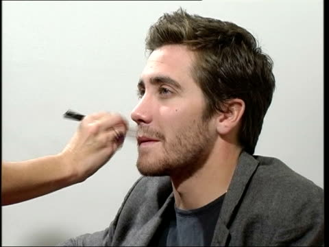 London INT Jake Gyllenhaal has makeup applied prior to interview'