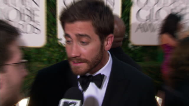 jake gyllenhaal talking to reporter on the red carpet at the beverly hilton hotel tu td golden globe awards sign - jake gyllenhaal stock videos & royalty-free footage