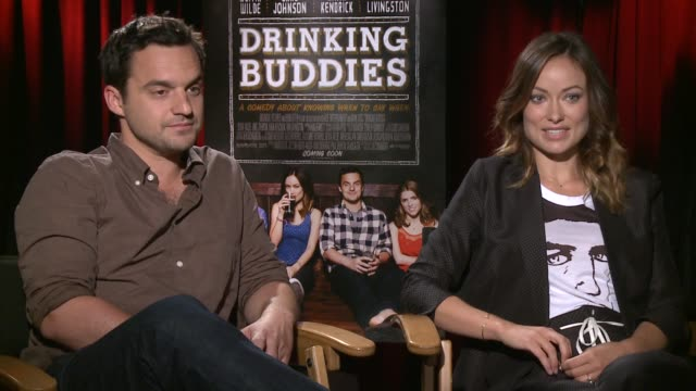 Jake Johnson Olivia Wilde on real life drinking buddies Jake Johnson Olivia Wilde on real life drinking at The Four Seasons Hotel on August 15 2013...