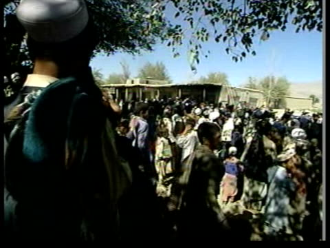ITN AFGHANISTAN Jalalabad EXT BV Group of Taliban fighters in truck as escorting journalists TRACK PAST People and vehicles on street BV Group of...
