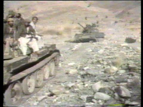 jalalabad guerrillas firing rockets towards jalalabad at night captured russian tanks along ammunition stockpile laden camels along pakistan peshawar... - afghanistan stock videos & royalty-free footage