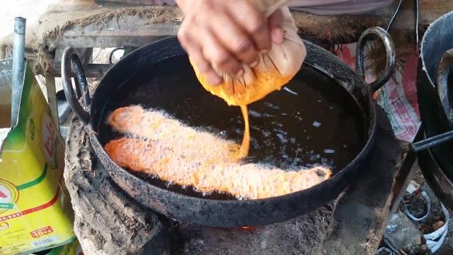 jalebi (spiral shaped in sugar syrup) - batter food stock videos & royalty-free footage