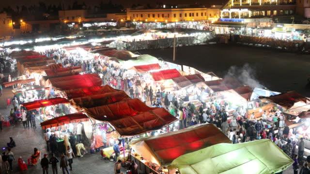 Jamaa el Fna, Jemaa el-Fnaa or Djema el-Fna. The main square and market place in Marrakeshs medina quarter the old city.