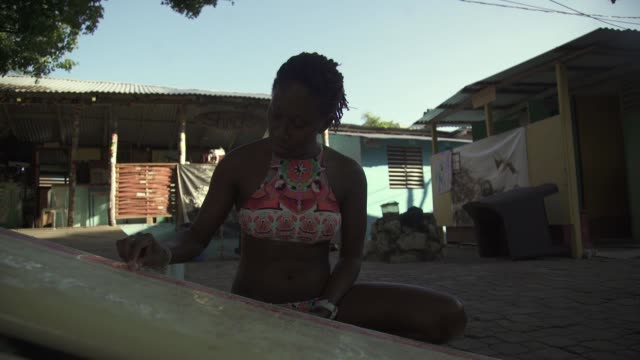 jamaican female surfer waxing her board - jamaican ethnicity stock videos and b-roll footage