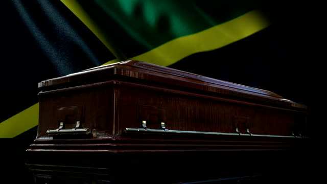 jamaican flag behind coffin - jamaican ethnicity stock videos and b-roll footage