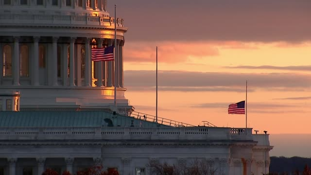 US senators attend CIA briefing USA Washington DC Capitol Hill EXT General view US Capitol Building with flags at half mast