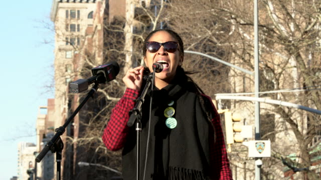 Jamara Mychelle Wakefield of the Black Lives Matter movement speaks at the International Working Women's Day rally in Washington Square Park New York...