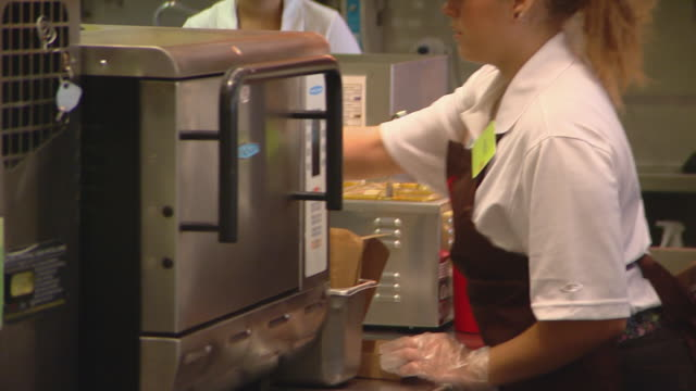 jamba juice employees making smoothies, wheatgrass to blender, employee working in kitchen, logo, smoothie pouring into cup, kitchen, store interior,... - part time worker stock videos & royalty-free footage
