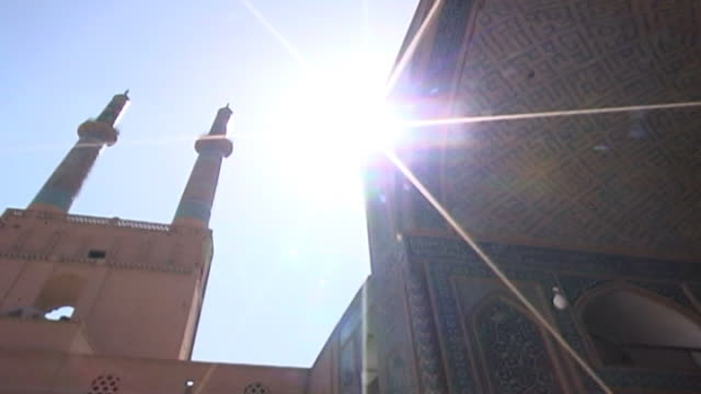 jameh mosque. low-angle pan-right from the minarets to the tiled entrance of the 12th century jameh mosque. the mosque is a fine specimen of the... - circa 12th century stock videos & royalty-free footage