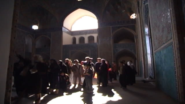 jameh mosque view of tourists visiting the 12th century jameh mosque the mosque is a fine specimen of the azari style of architecture - circa 12th century stock videos & royalty-free footage