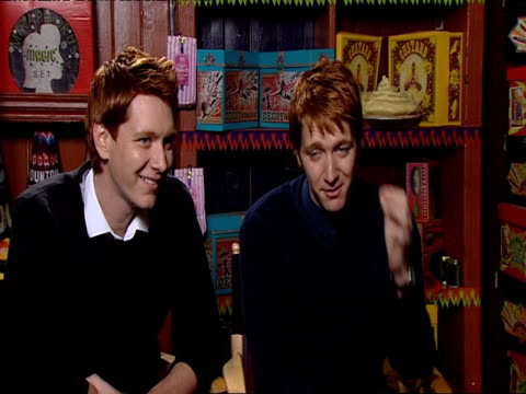 james and oliver phelps on how their ginger hair helps them come back into character but how the hair dye is not working as well as they get older at... - potter stock videos & royalty-free footage