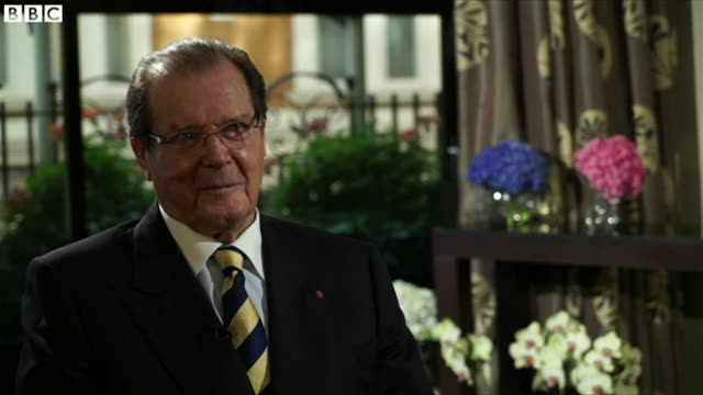 james bond actor roger moore interviewed by the bbc in late 2016 looks back at his career and discusses critics - bbc点の映像素材/bロール