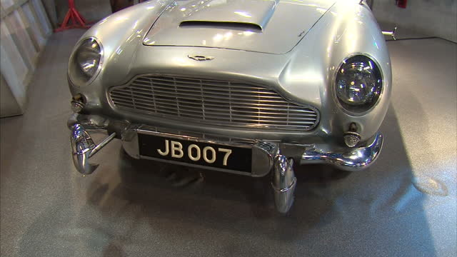 vídeos de stock, filmes e b-roll de james bond car used in goldfinger thunderball aston martin db5 for sale at auction interior shots of 1965 silver aston martin car including close ups... - james bond trabalho conhecido