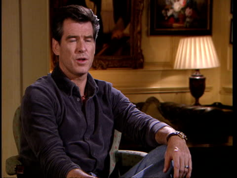 james bond film premiere; itn england: london: int 2 shot pierce brosnan interviewed sot - you can't be doing that nonsense that was going on in the... - james bond fictional character stock videos & royalty-free footage