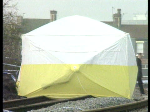 Liverpool LMS Police searching railway tracks where body was found LMS Tent around area where body was discovered MS Police photographers at scene GV...