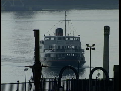 public reaction itn england merseyside docks gv boat along river towards dock gv river and docks bootle day lms ms taxi driver standing beside cab... - merseyside stock videos and b-roll footage