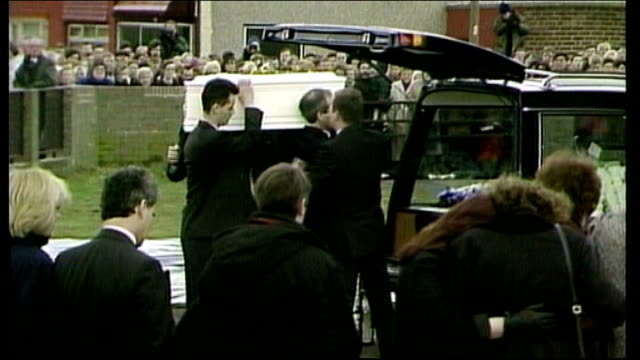 20th anniversary lib ext jamie bulger's coffin carried to hearse at his funeral coffin carried along aisle at funeral - murder stock videos & royalty-free footage