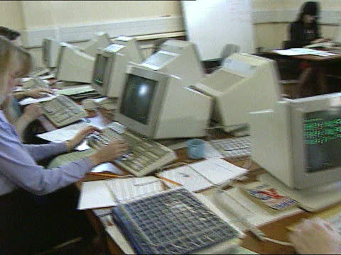 stockvideo's en b-roll-footage met ; c)13.00 england: lancashire: liverpool: int cms side womans hands typing on vdu keyboard side woman working at vdu in incident room pull out and... - crime and murder