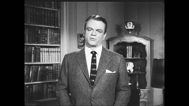 """james cagney putting book on bookshelf and walks to the front of the study, advocating for christmas seals; title card: """"this christmas seal message... - tuberculosis stock videos & royalty-free footage"""