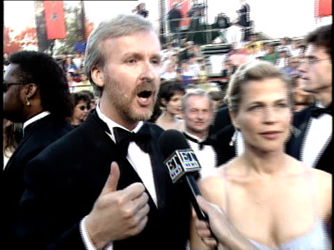 stockvideo's en b-roll-footage met james cameron amp linda hamilton talk to reporters on the red carpet at the 70th annual academy awards - 70e jaarlijkse academy awards