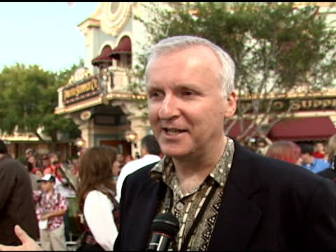 james cameron on why he's at the movie, movies with special effects like titanic and pirates, whether he'd really make an aquaman at the walt disney... - james cameron stock videos & royalty-free footage