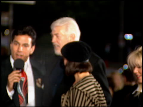 james coburn at the 'interview with the vampire' premiere at the mann village theatre in westwood california on november 9 1994 - レジェンシービレッジシアター点の映像素材/bロール