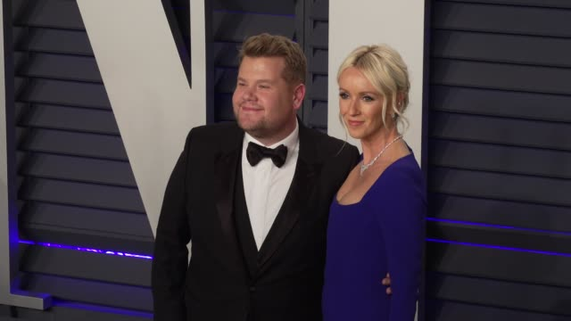 vídeos de stock, filmes e b-roll de james corden and julia carey at 2019 vanity fair oscar party hosted by radhika jones at wallis annenberg center for the performing arts on february... - vanity fair oscar party