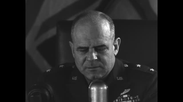 james doolittle, in uniform, sits at desk holding speech, prepares to read into cbs microphone, with american flag and union jack as backdrop /... - broadcasting stock videos & royalty-free footage