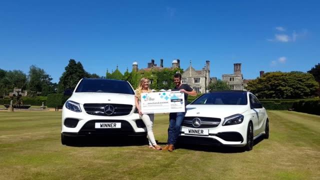 james evans and his partner jojo smith from romney marsh in kent, celebrate their £3 million national lottery scratchcard win at eastwell manor,... - lotterie stock-videos und b-roll-filmmaterial