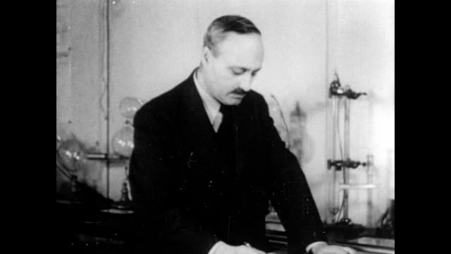 / james franck in laboratory / checks his watch makes notes / switches on experiment and returns to notebook physicist james franck works in the... - 1940 stock videos & royalty-free footage