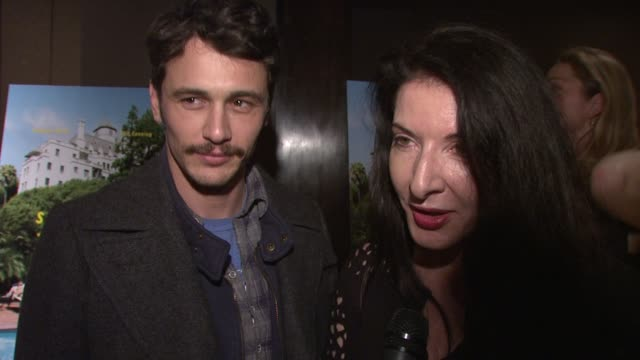 james franco and marina abramovic on coming out tonight on braving the rain to support sofia coppola at the 'somewhere' special screening at new york... - マリーナ アブラモヴィッチ点の映像素材/bロール