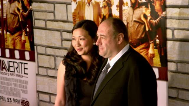 James Gandolfini and wife Deborah Lin posing for paparazzi on the red carpet at Paramount Studios