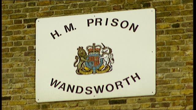 stockvideo's en b-roll-footage met james hurley arrested in holland date wandsworth prison hm prison wandsworth sign exterior of hm prison wandsworth - wandsworth