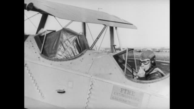 vídeos y material grabado en eventos de stock de james 'jimmy' doolittle performs first blind flight / doolittle in plane pulling hood over his head / doolittle narrates his flight: 'taking off... - narrar