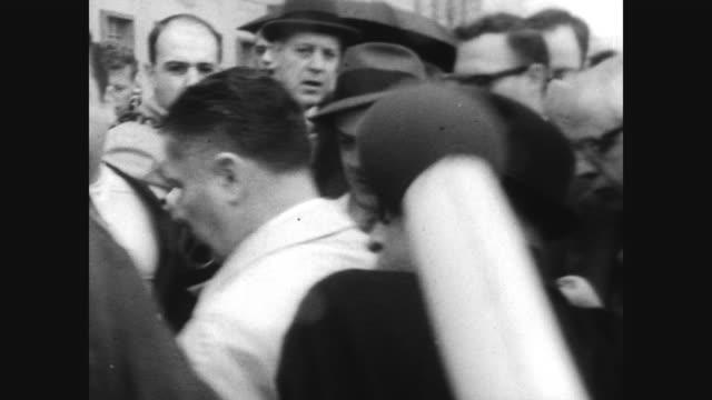 cu james 'jimmy' hoffa surrounded by us marshalls as he surrenders in washington / press and onlookers surround him as he makes his way into the... - federal prison building stock videos & royalty-free footage