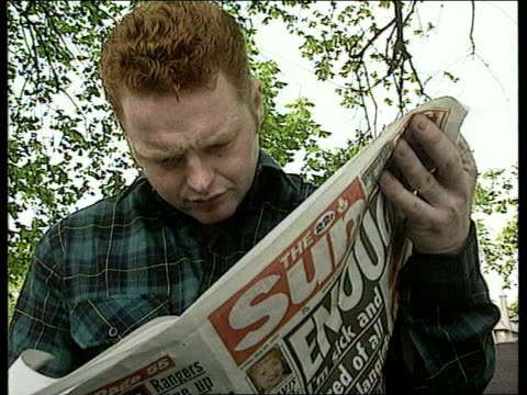 edinburgh james kelly along with kennedy in park kelly reading 'the sun' newspaper 2 shot james kelly intvwd i have right to stop the termination /... - abortion stock videos and b-roll footage