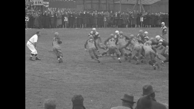 GV James Madison vs New Utrecht high school football game play in progress at Erasmus Field with crowds in stands in background in foreground men in...