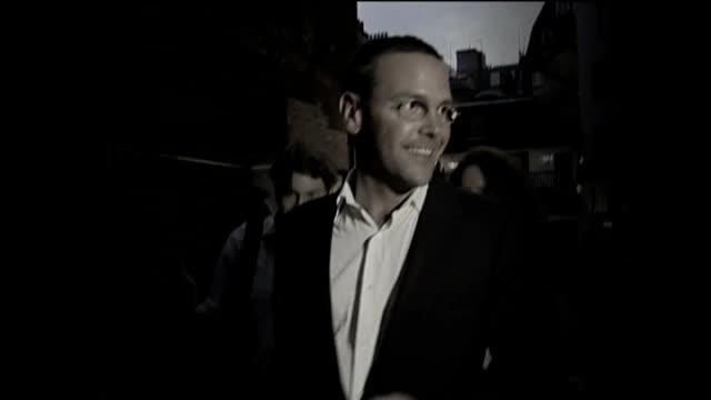 james murdoch resigns as news international chairman date unknown photography ** james murdoch along though press scrum - スクラム点の映像素材/bロール