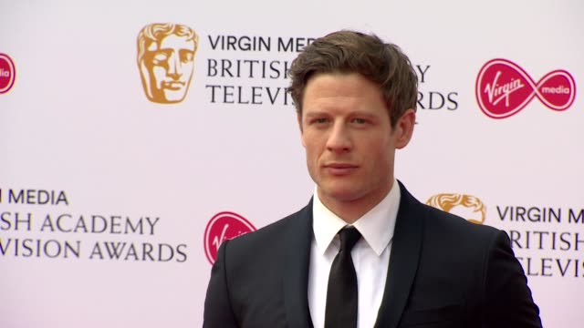 james norton poses for photos on red carpet at bafta tv awards 2019 at royal festival hall london - royal festival hall stock videos & royalty-free footage