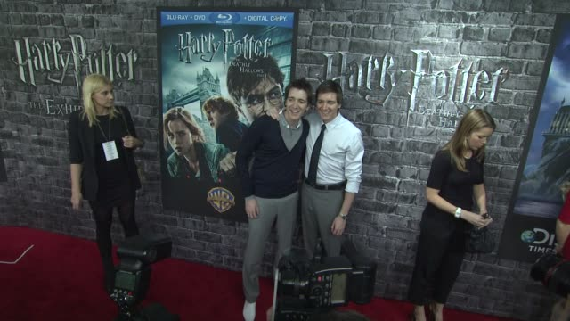 james phelps and oliver phelps at the launch event for the home entertainment release of harry potter and the deathly hallows part 1 at new york ny - oliver phelps stock videos & royalty-free footage