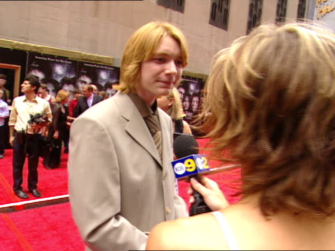 day james phelps standing on red carpet near radio city music hall talking to female reporter - radio city music hall stock videos and b-roll footage
