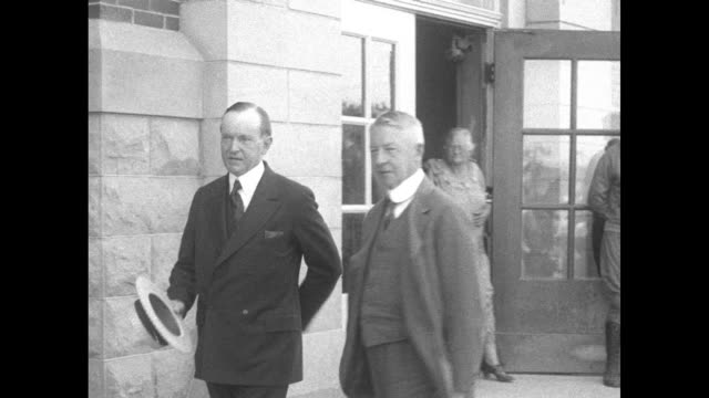 vídeos de stock e filmes b-roll de james sheffield and president calvin coolidge at left exit building and walk coolidge removes his straw boater but sheffield carries his in his hand... - rapid city