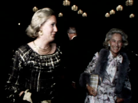 james stewart and guests arrive for dinner for prince charles; 1977 - fame stock videos & royalty-free footage