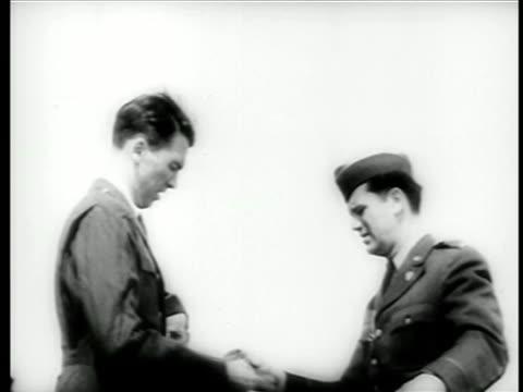 stockvideo's en b-roll-footage met james stewart putting on air force uniform as officer looks on / ww ii / documentary - in dienst gaan