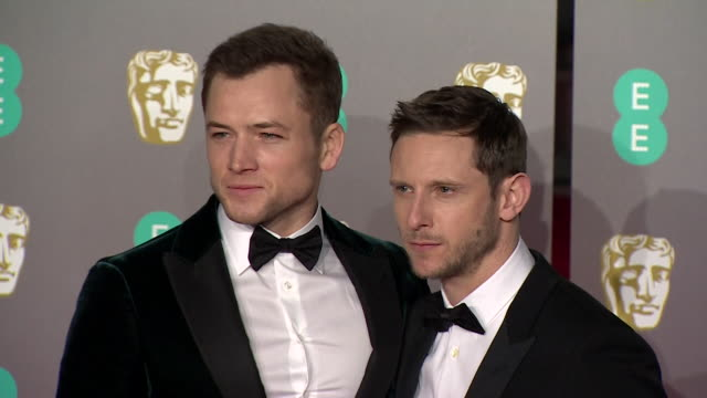 jamie bell and taron egerton pose for photos on red carpet at bafta film awards at royal albert hall - british academy film awards stock videos & royalty-free footage