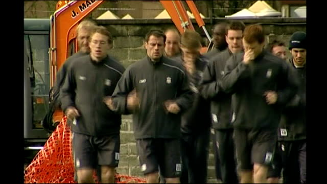 EXT Jamie Carragher running along among team mates at training session