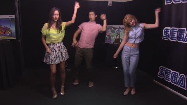 Jamie Chung Harry Shum Jr and Bella Thorne at Sega GO DANCE Mobile Game Unveil Party on September 05 2013 at STK New York New York