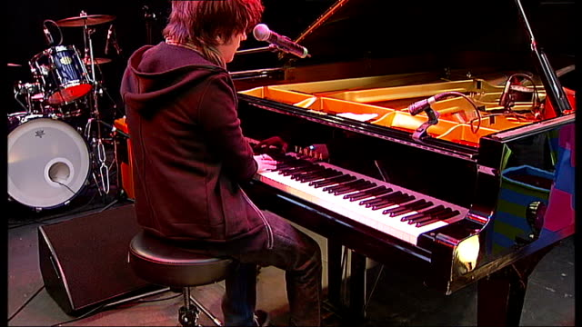 jamie cullum interview; jamie cullum performing on stage - crowds on oxford street watching sot - jamie cullum stock videos & royalty-free footage